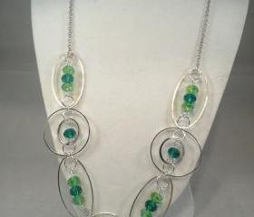 Fancy hoop and loop green necklace with green crystal accents